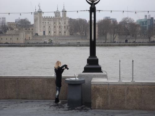 A tourist photographs the new sundial